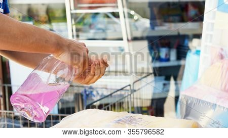 Avetrana, Italy, - Marth, 13, 2020. A Person Washes His Hands With Alcohol Disinfectant Before Enter