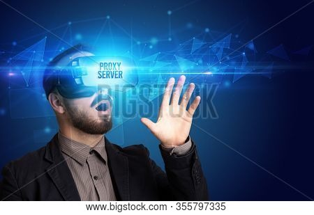 Businessman looking through Virtual Reality glasses with PROXY SERVER inscription, cyber security concept