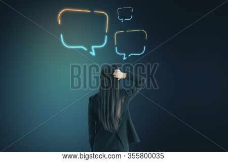 Businesswoman Thinking With Speech Balloons Over Head. Occupation And Worker Concept.
