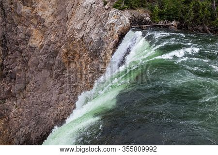 The Top Of Lower Falls In The Yellowstone River As The Green Water Drops Sharply Off A Cliff In Yell