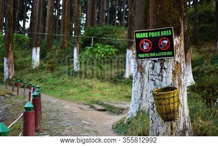 Garbage Cans In A Forested Area. Recycling Bin In Park For Protect Environment. Pollution Free Envir