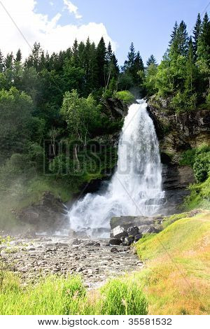 Waterfall Steinsdalsfossen Norway. The waterfall is one of the most visited in Norway. poster