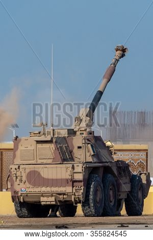 Military Tank Army Vehicle Of Guns And Military Personnel Aiming And Shooting.  Military And War Con