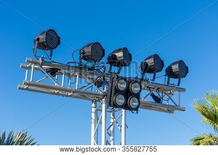 A Row Of Large Exterior Spot Lights On Blue Sky Background For A Sports Competition, Street Festival