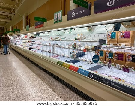 Orlando, Fl/usa-3/14//20: Empty Meat Counter Shelves At A Publix Grocery Store Due To The People Pan
