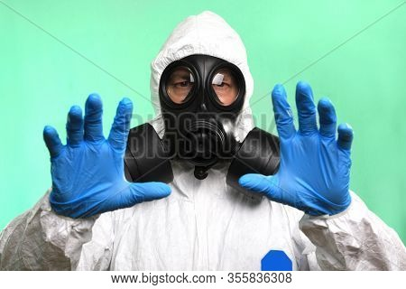 Male Lab Technician Wearing Gas Mask Working on Virus Vaccine