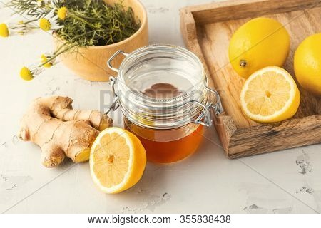 Alternative Medicine, Natural Home Remedy For Cold And Flu. Ginger, Lemon, Honey And Camomile Over B
