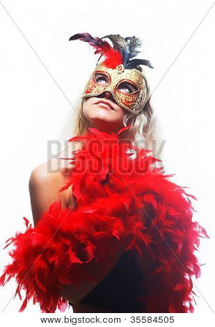 Portrait of attractive beautiful young woman wearing red carnival mask