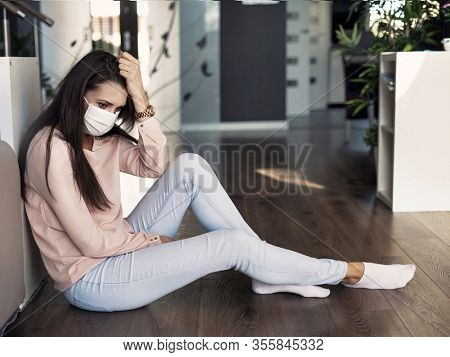 Young woman wearing hygienic mask