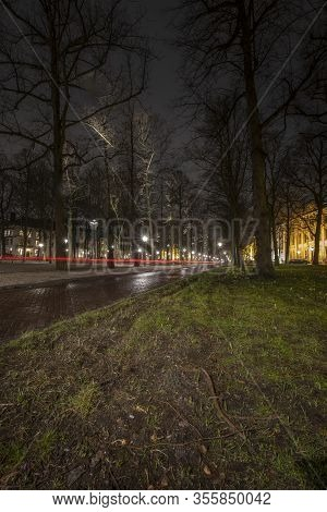 The Hague - January 18 2019: The Hague, The Netherlands. Park And Street In The Hague At Dusk, Long