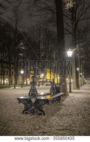 The Hague - January 18 2019: The Hague, The Netherlands. Park With Bench And Vintage Street Lanterns