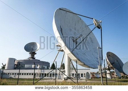 Barbed Wire Fence Around Satellite Links Center With Telecommunication Tower Equipped With Radar Ant