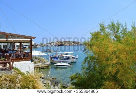 Hersonissos, Crete, Greece - June 11, 2019 : Boats In Hersonissos Harbour A Popular Tourist Attracti