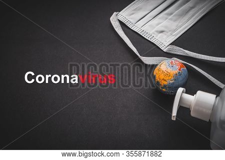 Coronavirus Text With Antibacterial Soap Sanitizer, World Globe And Protective Face Mask On Black Ba