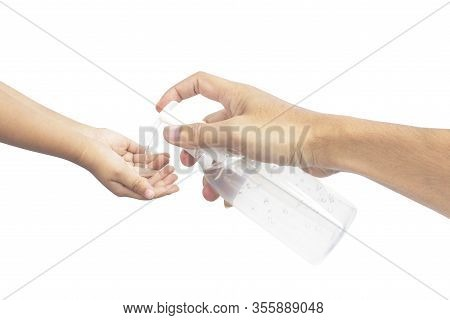 Man Using Squeezing Hand Sanitizer To Palm Kid. Sanitizing Hands To Protect From Getting Flu. Antiba