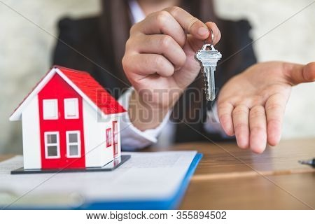 Close-up Of Real Estate Agents Holding House Keys For Clients. Ideas For Real Estate Business, Movin