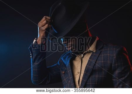 Cool African American Man In Black Hat On Dark Background