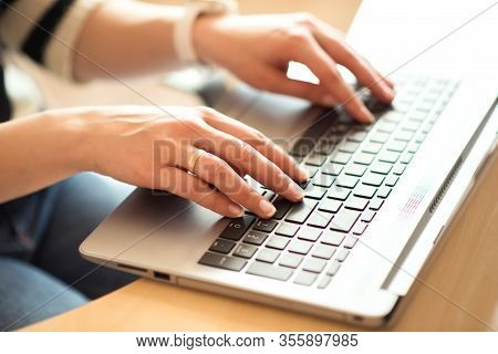 Woman Hands Typing On Laptop Computer Keyboard At Home, Working From Home, Internet Of Things Concep