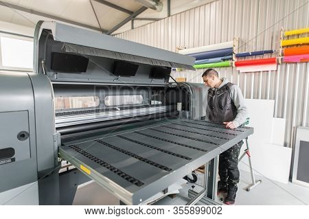 Electrical Engineer Operator Repairs Large Industrial Printer And Plotter Machine