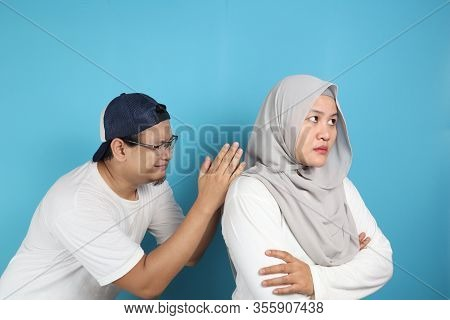 Husband Trying To Persuade And Apologize To His Wife