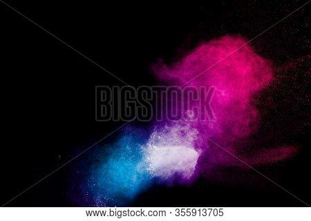 Multicolored Powder Explosion On Black Background.color Dust Splash Cloud On Dark Background.launche