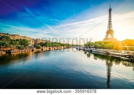 Paris Eiffel Tower And City Of Paris Reflecting In River Seine At Sunrise In Paris, France. Eiffel T