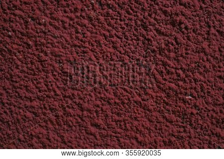 Abstract Red Stucco Wall. Texture Of An Old Wall Covered With Red Stucco. Background Texture Concret