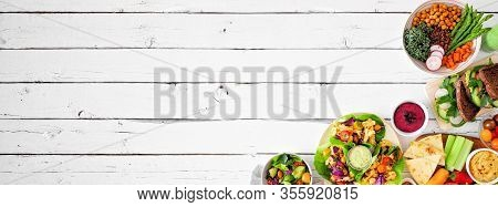 Healthy Lunch Food Corner Border. Table Scene With Nutritious Lunch Bowl, Sandwiches, Vegetables, Le