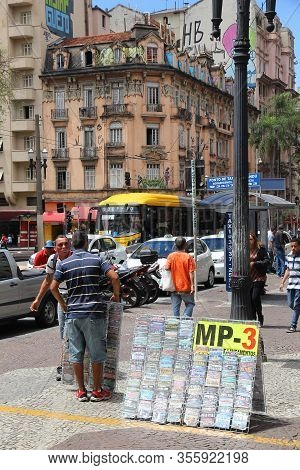 Sao Paulo, Brazil - October 6, 2014: Street Vendor Sells Bootleg Pirated Music Cds In Mp3 Format In