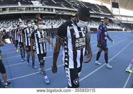 Rio, Brazil - March 15, 2020: Players Enter The Field Wearing Masks As A Warning To Covid-19 In Matc
