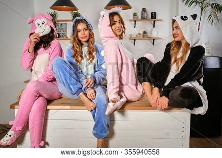 Gorgeous Females Dressed In Plush Pajamas In Form Of Cartoons Characters Are Having Fun At Bachelore