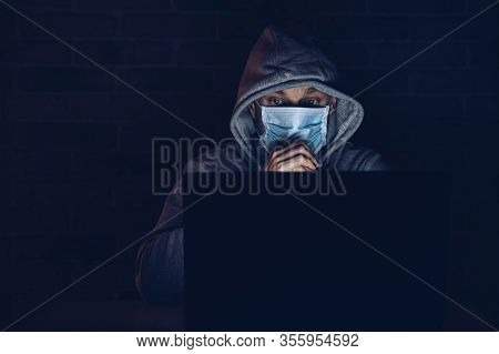Frightened Man In Medical Mask Reading Informations About Coronavirus Covid-19