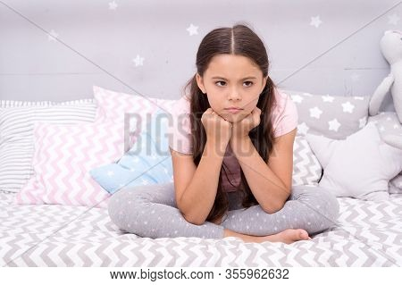 Unhappy Cutie. Unhappy Baby Sit In Bed. Little Child With Unhappy Look. Bedtime Routine. Daytime Nap