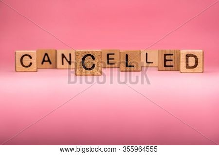 Cancelled Word Made With Building Blocks, Business Concept. Word Cancelled On Pink Background. Globa
