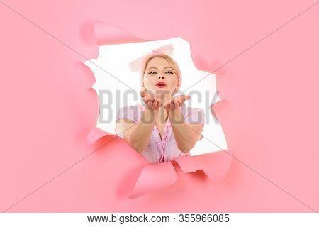 Air Kiss. Through Paper. Woman Through Paper. Pin Up Woman Looking Through Paper. Pin Up Woman Send