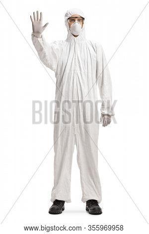 Full length portrait of a man wearing a decontamination suit and gesturing stop isolated on white background