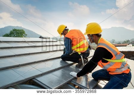 Engineers Worker Install New Cpac Roof,roofing Tools,electric Drill Used On New Roofs With Cpac Roof