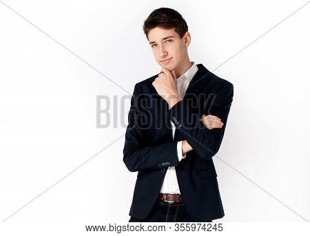 Handsome Teenage Boy In Elegant Clothes.