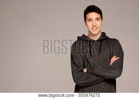 Handsome Teenage Boy In Hoodie.