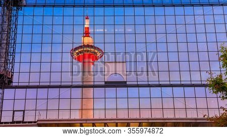 Kyoto, Japan - April 27, 2017: Kyoto Tower With Observation Deck, Reflects On Glass Facade Of Kyoto