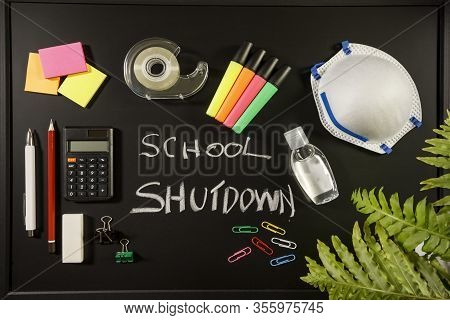 Caronavirus School Shutdown Concept With Personal Mask, Hand Sanitizer And Stationery On Black Flat