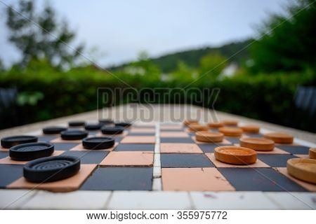 Low Angle Of Mosaic Checkerboard On Park Table