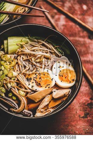 Japanese Traditional Ramen Soup Bowl With Chicken And Shiitake Mushrooms