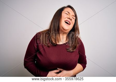 Beautiful brunette plus size woman wearing casual sweater over isolated white background with hand on stomach because nausea, painful disease feeling unwell. Ache concept.