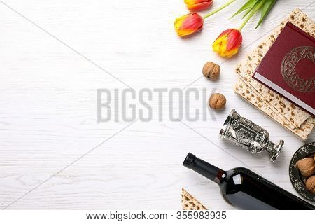 Flat Lay Composition With Symbolic Pesach (passover Seder) Items On White Wooden Table, Space For Te