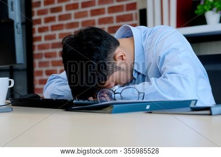 Asian Man Stress At Work, Frustrated Young Asia Businessman Take A Break From Working With Computer