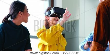 Vr Application Test, Asian Woman With Virtual Reality Glasses Headset Touching Air During The Vr Exp