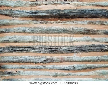 Wood And Clay Or Adobe Wall Or Background