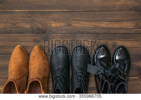 A Set Of Three Pairs Of Womens Leather Shoes On A Wooden Background. Fashionable Womens Leather Shoe