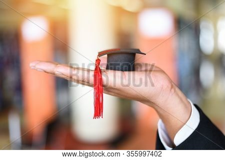 Business Man Or Student With Graduation Cap On Hand In Day Graduation Congratulated The Graduates In